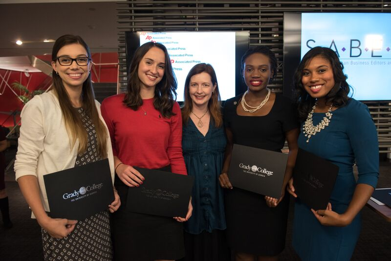 SABEW president Joanna Ossinger (center) presented students (left to right) Kinsey Lee Clark, Grace Donnelly, Brittney Laryea and Kendall Trammell with certificates during the SABEW Fall 2015 conference.